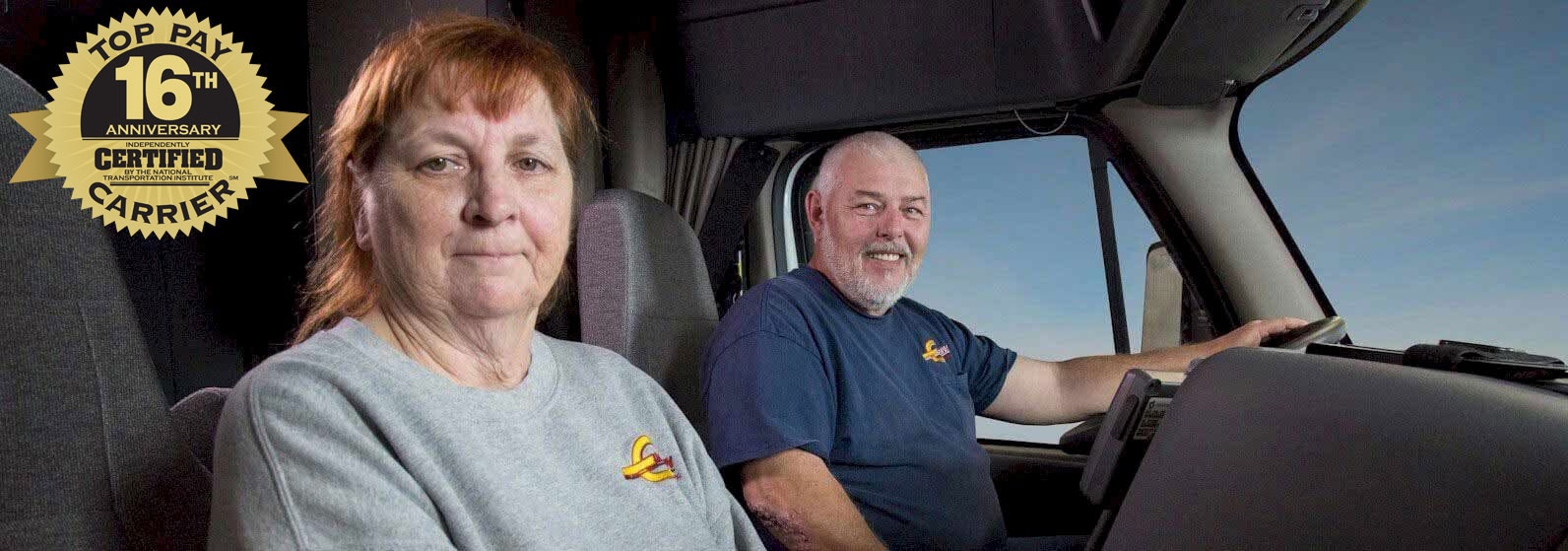 Barr-Nunn Team Truck Drivers in their truck with the Top Pay Certified Carrier logo