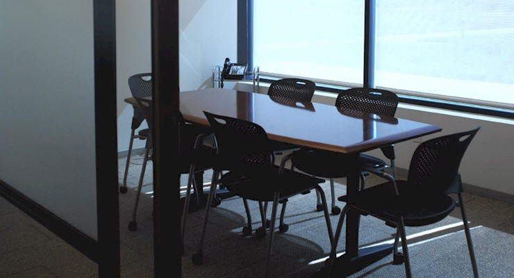 Barr-Nunn Transportation Corporate Headquarters small conference room showing table with chairs and phone system