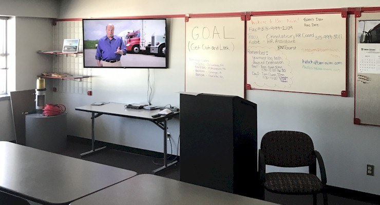 Barr-Nunn  Des Moines, IA area truck driver training classroom showing desks, whiteboard, and company video