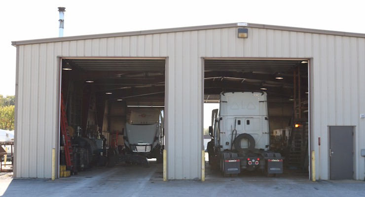 Barr-Nunn Manchester, PA truck terminal building exterior showing vehicles in maintenance and service bays